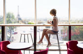 Beautiful girl in a cafe in Paris — Stock Photo