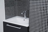 Modern sink in black and white — Stock Photo