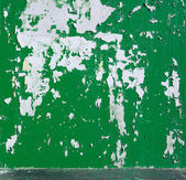 Background peeled green scarlet paint on the wall — Stock Photo
