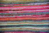 Strip woven colorful rug surface close up. — Stock Photo