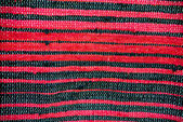 Strip woven red and black rug surface close up — Stock Photo