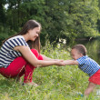 Mother and son in the park near lake — Stock Photo #49392337