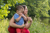 Young mother with the emotional  child — Stock Photo