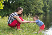 Mother and son in the park near lake — Stock Photo