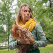 Young woman in city park with her small dog — Stock Photo #49472945