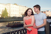 Young man and woman stand on the city embankment — Stock Photo