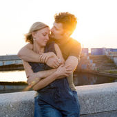 Happy young couple embracing in sunset light — Stock Photo