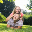 Attractive couple cuddling at the lawn — Stock Photo