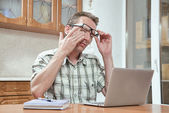 Tired student rub his eyes — Stock Photo