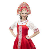 Smile young woman hands on hips portrait  in russian traditional costume --  red sarafan and kokoshnik. — Stock fotografie
