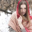 Portrait of the young beautiful girl with red scarf in the winte — Stock Photo #28891723