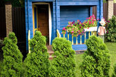 Beautiful porch of a child house in the garden — Stock Photo