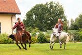 Two girls riding pony — Stock Photo