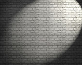 Old stone wall with lights — Stock Photo
