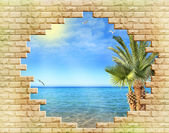 Resort seascape, view through a hole in a stone wall — Stock Photo