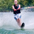 Постер, плакат: Active senior man on slalom ski