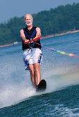 Senior waterskis — Stock Photo