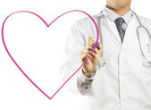 Doctor drawing a heart symbol — Stock Photo
