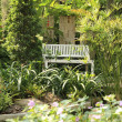 White chair in garden — Stock Photo