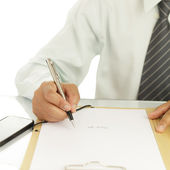 Businessman signing a document — Stok fotoğraf