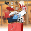 Red shopping bag and wide variety of products — 图库照片