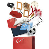 Red shopping bag and wide variety of products — Stock Photo