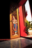 Light through the door Thai style wood carving — 图库照片