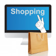 Paper shopping bags and computer — Stock Photo