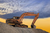 Silhouetted Digging Machine — Stock Photo