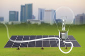 Light bulb and Solar energy plants — Stock Photo