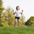 Girl jump in the park — Stock Photo