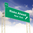 Stock Photo: Road sign concept with text Risks Ahead