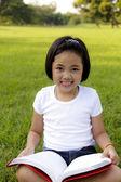 Asian girl reading book — Stock Photo