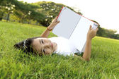 Little girl relax and reading a book in the park — Stock Photo