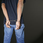 Murderer locked in handcuffs — Stock Photo