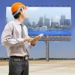 Engineers and architects using digital tablet — Stock Photo