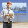 Engineers and architects using digital tablet — Stock Photo #27779831