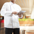 Chef using digital tablet — Stock fotografie