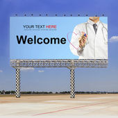 Doctor writing welcome — Stock Photo