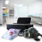 Camera and printer with picture of a newborn baby in the hospita — Stock Photo