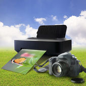 Camera and printer with picture of a butterfly — Photo