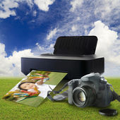 Camera and printer with picture — Stock Photo