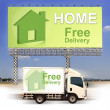 White van with Free delivery and large outdoor billboard — Stock Photo #27790995