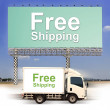 White van with Free Shipping and large outdoor billboard — Stock Photo #27791239