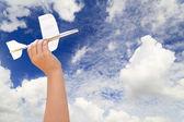 Hand holding airplane model — Stock Photo