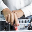 Technician repairing computer hardware — Stock Photo