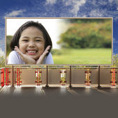 Asian little girl relax and smiling on billboard — Stock Photo