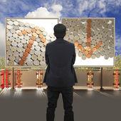 Businessman standing in front Financial billboard — Stock Photo