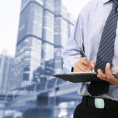 Businessman signing a document — Stock Photo