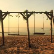 Double swings on the beach — Stock Photo